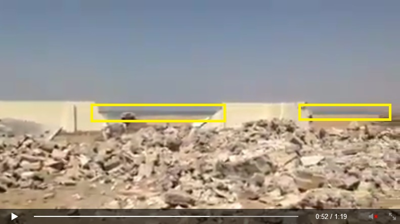 'Yezidi holy place/sacred site Quba Sheikhsin destroyed by IS terrorists. [Von IS-Terroristen zerstörte êzîdîsche Heiligenstätte Quba Sheikhsin.]'<br />(c) Ezidi Press, Facebook, 1. September 2014 (e) - is that water on the horizon?