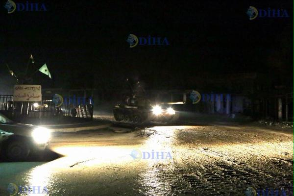 'In colloboration with the PKK, Turkish tanks passing through YPG checkpoint in #Kobane to secure Suleiman Sheikh Tomb' (c) Amed News Agency, Twitter, 22nd February 2015