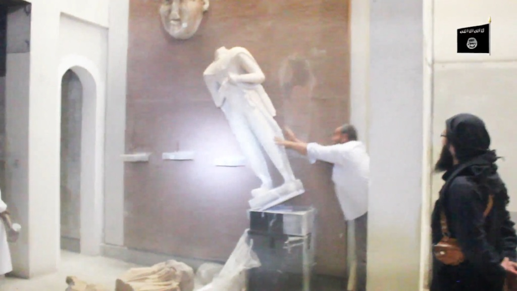 Destruction of artefacts and reproductions in Mosul Museum by Islamic State (MediaFire, 00h03m16s a, 26th February 2015)