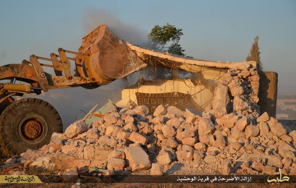 demolition of tombs in a village under Islamic State rule